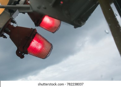Low angle view of red light signal from lamp on height building sign for warning to protect  dangerous crash from the plane