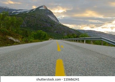 Low angle view of a road with a steep mountain as background