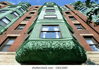 Low Angle View Of Running Bay Windows With Aged Copper Awning Elaborate Ornaments Green