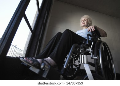 Low angle view of a senior woman in wheelchair