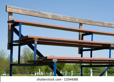 Low angle view of a set of school bleachers, shot against a blue sky