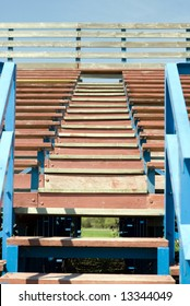 A low angle view of a set of stairs climbing up some school bleachers
