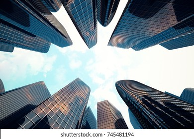 Low angle view of skyscrapers. Skyscrapers at sunset looking up perspective. Bottom view of modern skyscrapers in business district in evening light at sunset. Business concept of success industry