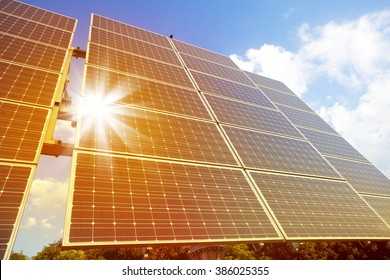 Low angle view of solar photovoltaic cell panels in bright sunlight.