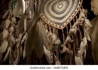 Low angle view of some beautiful Dreamcatcher hanging from a ceiling at the Love Anchor Market in Canggu, Bali - Indonesia