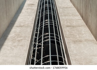 Low angle view of a spiral external fire escape staircase of a building