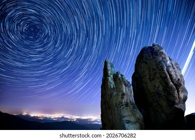 Low angle view of star light trajectory on night sky above Sinseondae Cliff at Seonginbong Peak of Seoraksan National Park near Goseong-gun, South Korea