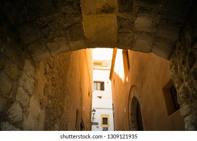 Low angle view of the streets of the old town of Ibiza, Balearic Islands, Spain. Vacation, travel destination, culture and architecture concept.