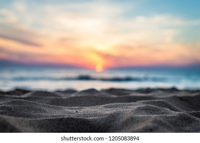 Low angle view of subset over a beach
