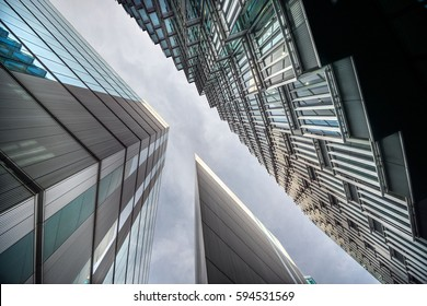 Low angle view of tall corporate glass buildings. Southwark, London