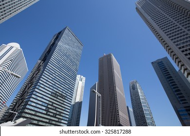 Low angle view of Tokyo skyscraper district with office buildings