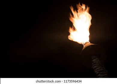 Low Angle View Torch Burning in Black Night