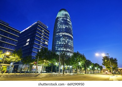 Low angle view of the Torre Agbar tower illuminated at night in Barcelona