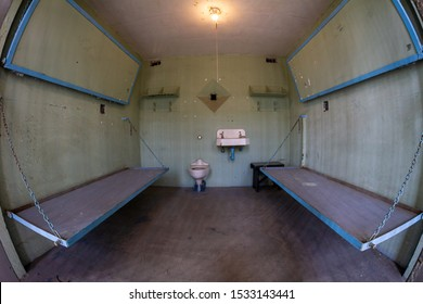 Low angle view of uncomfortable prison beds