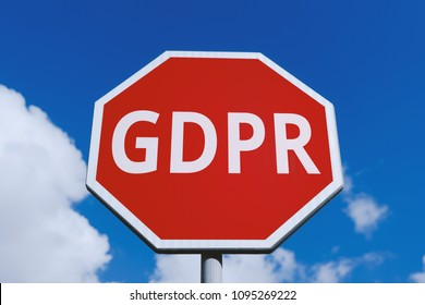 Low angle view of warning road sign stop with GDPR symbol against blue sky. General Data Protection Regulation (GDPR) Concept - Europe 25 May 2018