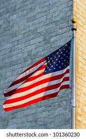 Low angle view of Washington Monument and American Flag, Washington DC, USA
