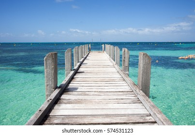 Low angle view of wooden jetty reaching into the turquoise Indian Ocean waters at Rottnest Island in Western Australia/Jetty View at Rottnest Island/Western Australia