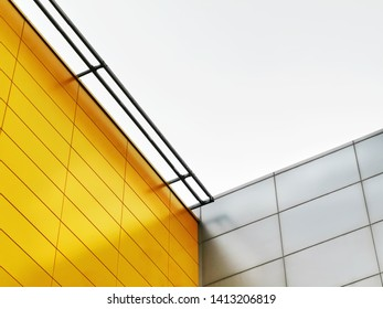 Low Angle View of Yellow and Silver Tiled Walls Against Sky