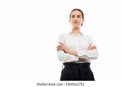 Low angle of young pretty bussines woman standing with arms crossed isolated on white background with copyspace advertising area
