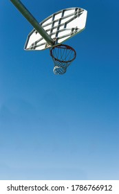 Low angled view of a basket ball net and hoop and backboard