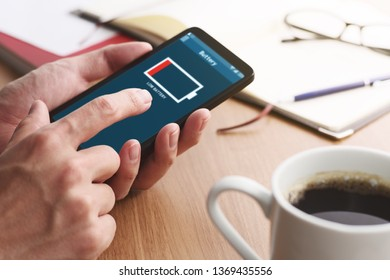 Low battery alert on smartphone screen.