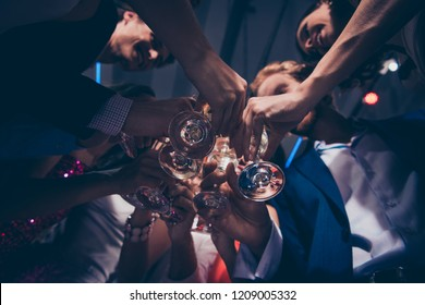 Low below angle view of diverse charming stylish cheerful ladies and trendy gentlemen in formal-wear, corporate company event, clinking wine glasses, chill out at fasionable night club, gathering