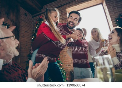 Low below angle view of noel morning couple gathering, tradition. Grey-haired cheerful excited grandparents, grandchildren sister, brother son daughter at house feast lunch table dad piggybacking girl