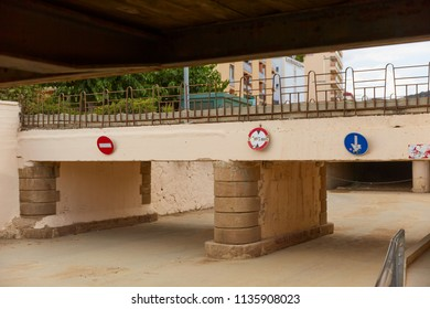 Low bridge with road signs in the afternoon in Calella, Spain.