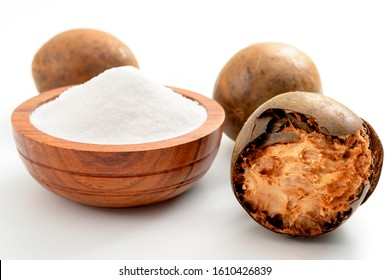 Low calorie alternative to sugar and natural remedy for inflammatory disease and arthritis conceptual idea with Luo Han Guo or Monk fruit and bowl of powder sweetener isolated on white background