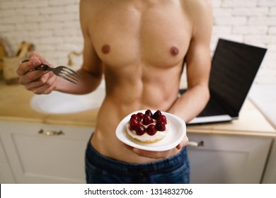 low calorie dessert, sugar addiction, nutrition choices, fit sporty muscle man fighting the temptation to eat sweet cake