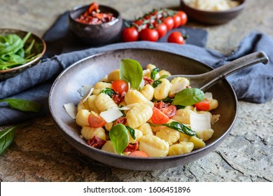 Low calorie gnocchi pasta salad with fresh and steamed spinach, sun dried tomatoes and Parmesan cheese