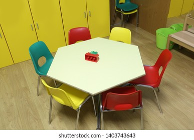 low chairs and hexagonal table of a kindergarten class without children