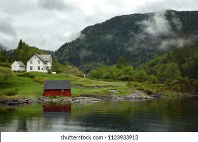 Low cloud clinging to the mountainside in the fjord near Bergen in Norway