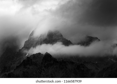 Low clouds around peaks of french alps