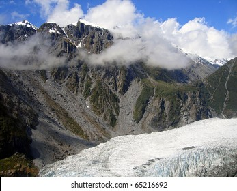 Low Clouds over Fox Glacier, within the Te Wahipounamu UNESCO World Heritage Area, New Zealand