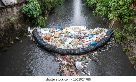 Low cost garbage filtering system that catches all forms of rubbish in a dirty flowing river in Cebu City, Philippines.