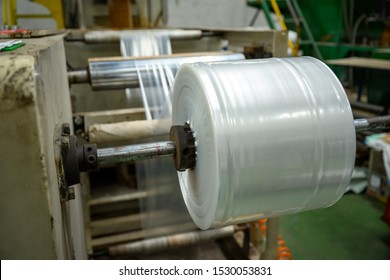 Low density polyethylene (LDPE) film production machinery is working in a plastic bag factory.