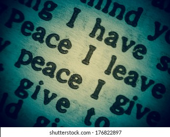 """Low Depth of Field macro shot of a Bible text from the Gospel of John chapter 14 verse 27 with the words of Jesus saying """"Peace I leave with you; my peace I give you."""""""