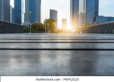 Low ground angle view of wooden footpath front modern building