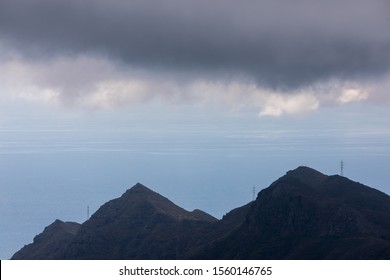 Low hanging clouds over a ridge line and the ocean in Parque Rural de Anaga,Tenerife,Spain.