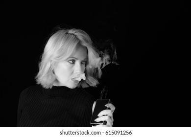 Low Key Black and White Of Woman Holding Vape