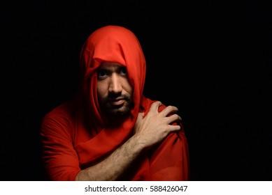 Low Key High Key Portrait of an Arabic Man in Red Hood