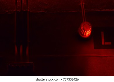 low key Illuminated industry factory red alert emergency light with copy space for background