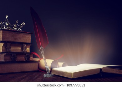 low key image of beautiful queen/king crown, old books and feather quill ink pen over wooden table. fantasy medieval period - Shutterstock ID 1837778551
