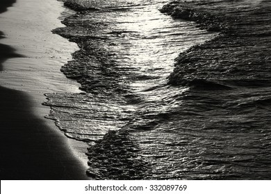 low key image of sea waves pattern, black and white.