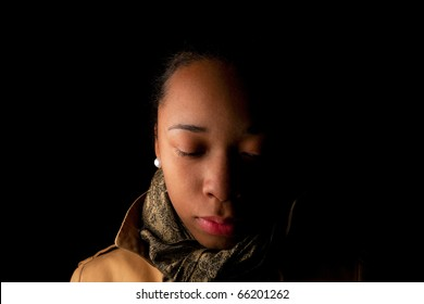 Low key image of a young lady expressing her feelings