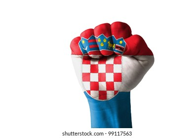 Low key picture of a fist painted in colors of croatia flag