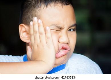 Low key Portrait of Boy got punch/Slap in the face.