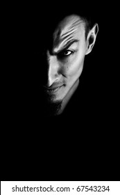 Low key portrait of evil. Dark portrait of devil looking man