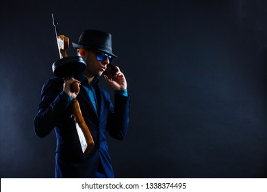 low key portrait of young gangster with hat in the darkness